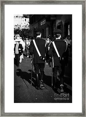 two italian police officers with ceremonial swords go along Via Borgognona towards the Spanish Steps Rome Lazio Italy Framed Print by Joe Fox