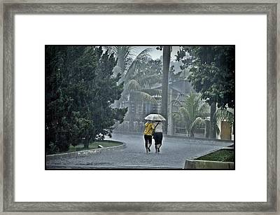 Two Ladies With One Umbrella Framed Print by Achmad Bachtiar