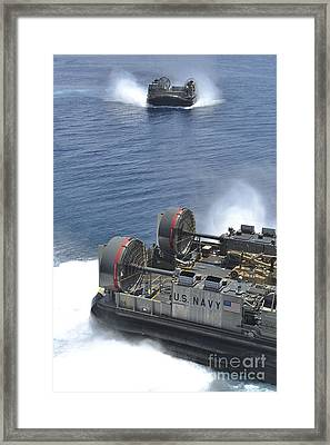 Two Landing Craft Air Cushions Depart Framed Print by Stocktrek Images