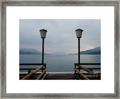 Framed Print featuring the photograph Two Lanterns At The Jetty Pier Of Lake Attersee by Menega Sabidussi