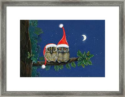 two little owls with Christmas caps Framed Print by Marina Durante
