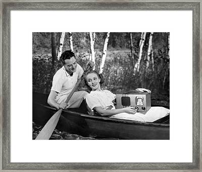 Two Lovers In A Canoe Framed Print by Underwood Archives