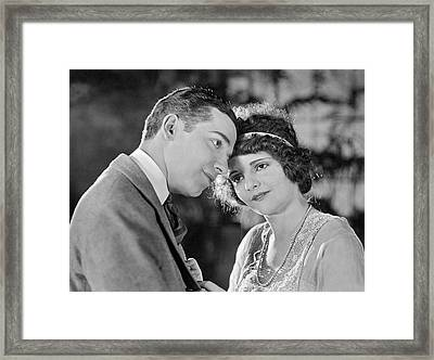 Two Lovers Put Heads Together Framed Print