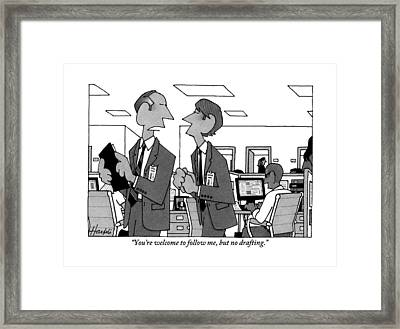 Two Men In Suits Walk Through An Office Framed Print