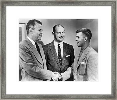 Two Men Shake Hands Framed Print by Underwood Archives