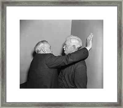 Two Men Talking Framed Print by Harris & Ewing