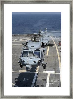 Two Mh-60s Sea Hawk Helicopters Take Framed Print by Stocktrek Images