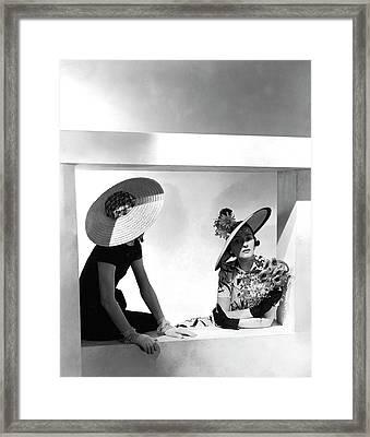 Two Model Sitting In A Window Framed Print