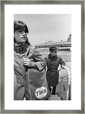 Two Models Boarding A Plane Framed Print by Leonard Nones