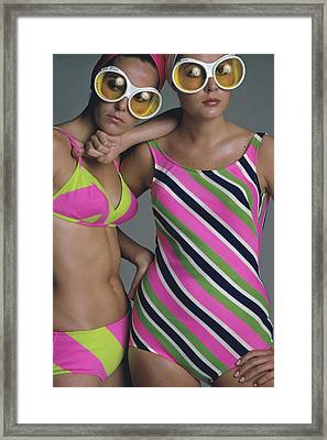 Goggles And Striped Swimsuits Framed Print