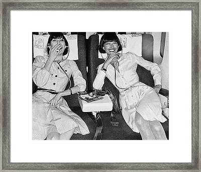 Two Models Laughing At A Movie In An Iberia 747 Framed Print