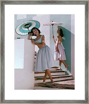 Two Models Posing With Parasols Framed Print