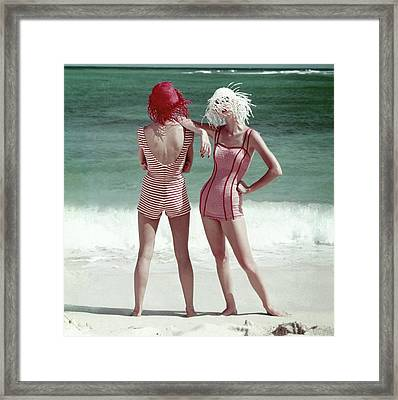 Two Models Standing On A Beach Framed Print