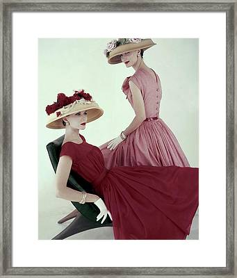Two Models Wearing Red Dresses Framed Print by Karen Radkai