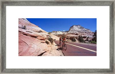Two People Cycling On The Road, Zion Framed Print by Panoramic Images