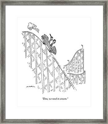 Two People Ride A Roller Coaster Framed Print