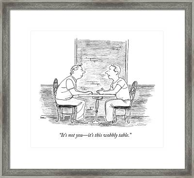 Two People Sit At A Table Framed Print