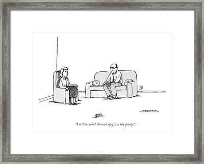 Two People Sit In A Room With One Framed Print