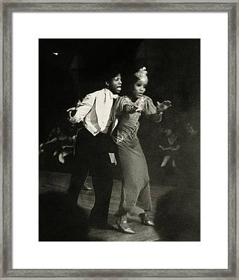 Two Performs Singing And Dancing On Stage Framed Print
