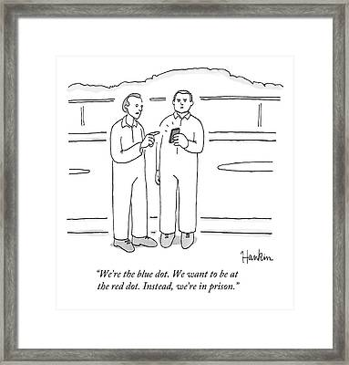Two Prison Inmates Look At A Smartphone Together Framed Print by Charlie Hankin