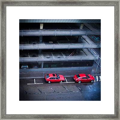 Two Red Cars In The City Framed Print