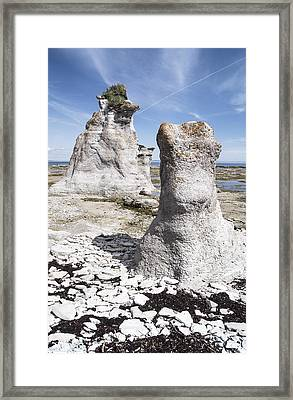 Framed Print featuring the photograph Two Sculpted Rocks On Naked Isld by Arkady Kunysz