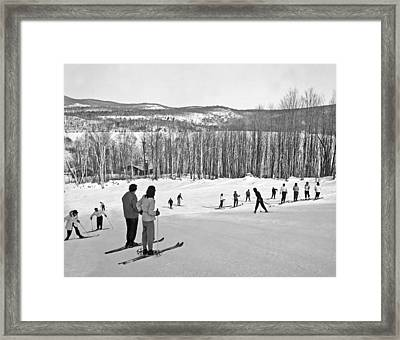 Two Skiers Pause On A Slope Framed Print by Underwood Archives