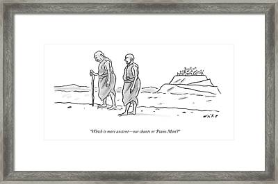 Two Tibetan Monks Walk Together Framed Print by Kim Warp