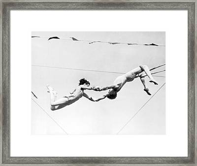 Two Trapeze Artists Framed Print by Underwood Archives