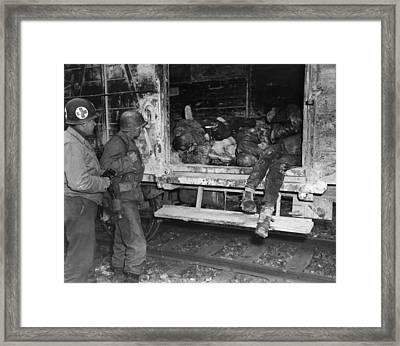 Two U.s. Soldiers Looking At Dead Framed Print