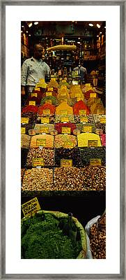 Two Vendors Standing In A Spice Store Framed Print