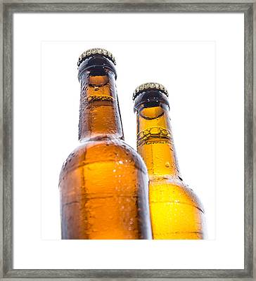 Two Wet Bottles Of Beer On White Framed Print by Handmade Pictures