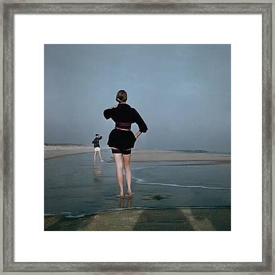 Two Women At A Beach Framed Print