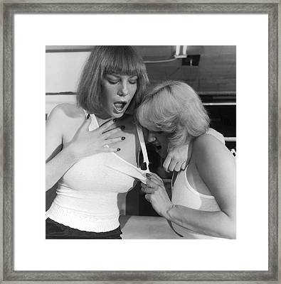 Two Women Fighting Framed Print by Underwood Archives