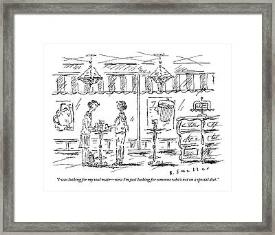 Two Women Stand At A Table In A Cafe Framed Print by Barbara Smaller