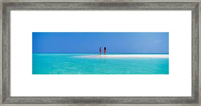 Two Women Standing On The Beach Framed Print by Panoramic Images