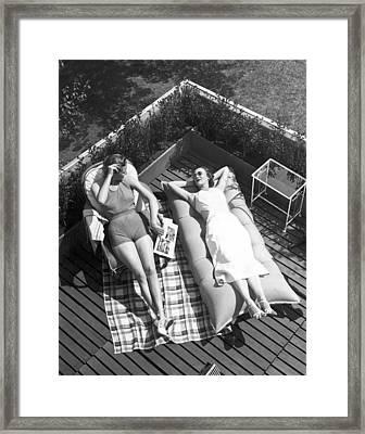 Two Women Sunbathing Framed Print by Underwood Archives