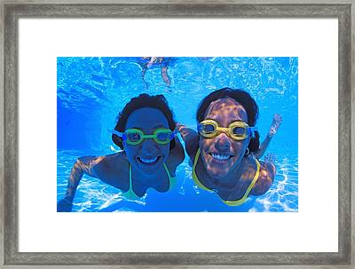 Two Women Underwater In Pool Framed Print by Carson Ganci