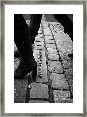 two women walking across double row of bricks across berlin to mark the position of the berlin wall berliner mauer Berlin Germany Framed Print
