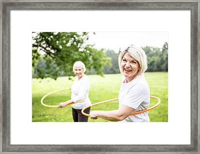 Two Women With Plastic Hoops Framed Print by Science Photo Library