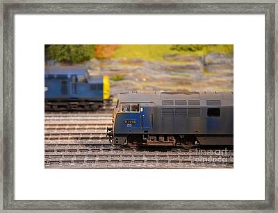 Framed Print featuring the photograph Two Yellow Blue British Rail Model Railway Train Engines by Imran Ahmed
