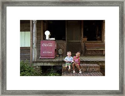Two Young Children Pose On The Steps Of A Historic Cabin In Rural Alabama Framed Print