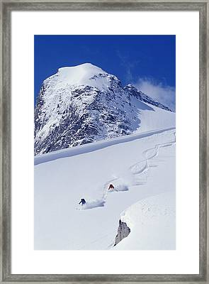 Two Young Men Skiing Untracked Powder Framed Print by Henry Georgi Photography Inc
