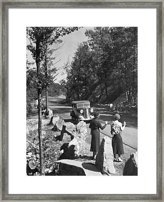 Two Young Women Hitchhiking Framed Print by Underwood Archives
