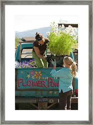 Two Young Women Load Their Landscaping Framed Print