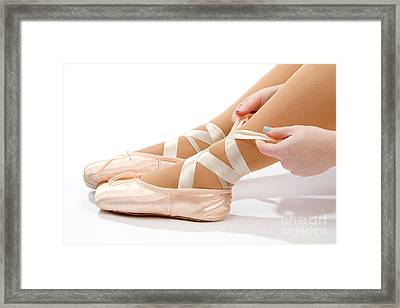Tying Ballet Slippers Framed Print