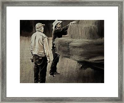 Tying The Load Framed Print