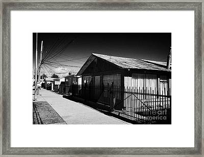 typical chilean construction house with metal tin roof las naciones Punta Arenas Chile Framed Print