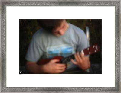 Uke Player Framed Print