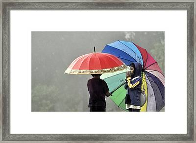 Umbrella For Rent Framed Print by Achmad Bachtiar